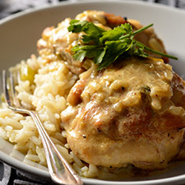 Chicken thighs in a creamy mustard sauce, served with creamy rice