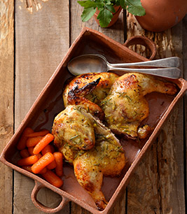Honey, lemon and thyme chicken spatchcock served with glazed carrots